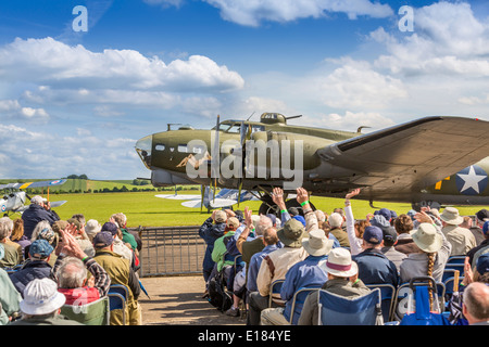 Sally B, a Boeing B17 Flying Fortress, taxi past fans and spectators at a Duxford airshow, Duxford ,Cambridge, England - Stock Photo