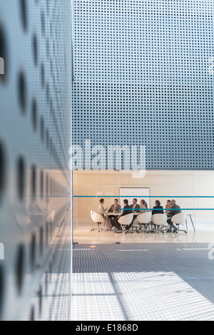 Business people in conference room in modern office - Stock Photo