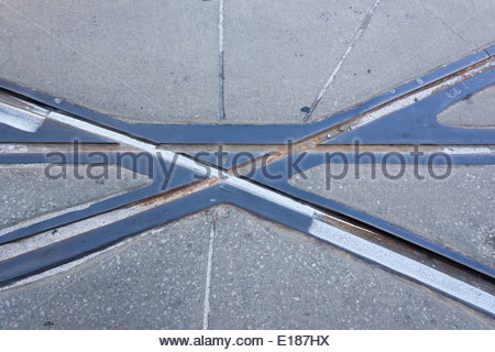 Abstract of the streetcars rails in Toronto. Detail of railroad in the street concrete. - Stock Photo