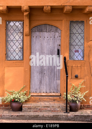 Oak door and leaded windows on old Medieval half timbered oak post and beam house of Little Hall, Lavenham, Suffolk, - Stock Photo
