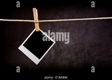 Photography Paper Attached To Rope With Clothes Pins With Copy Space