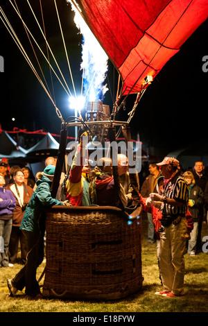 Hot air balloon crew in basket and gas flame, Albuquerque International Balloon Fiesta, Albuquerque, New Mexico USA