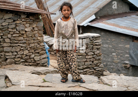 Children, Nepal,Asia,Young girl posing for photo on stone stairs, scenes photos,coldly, cute,this is life, - Stock Photo