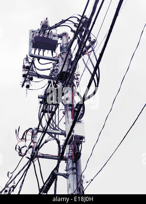 Complex busy electric overhead wiring in Tokyo Japan - Stock Photo
