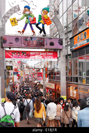Busy, crowded with yopung people, fashion clothing shopping street Takeshita in Harajuku, Tokyo, Japan. - Stock Photo