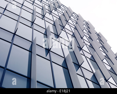 Abstract modern architecture, glass and metal building wall detail background. Tokyo, Japan. - Stock Photo