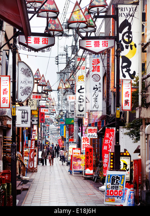 Narrow street filled with colorful restaurant signs in Nakano, Tokyo, Japan. - Stock Photo
