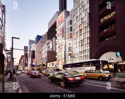 Cars on Chuo Dori street in the evening. Ginza, Tokyo, Japan. - Stock Photo