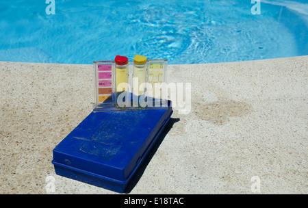 Swimming pool water testing kit - Stock Photo