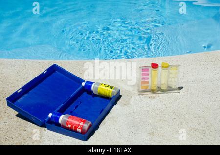 Testing kit for swimming pool water - Stock Photo