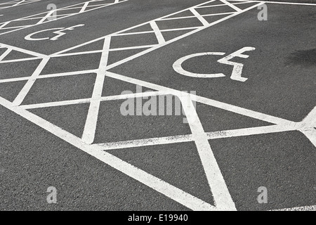 Disabled parking space or bay reserved for people with disabilities and extra space for loading a wheelchair - Stock Photo