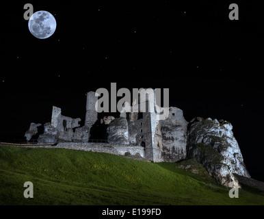 Full moon above ruins of castle, Ogrodzieniec, Poland. - Stock Photo