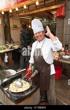 Chef preparing street food in the Old City, Shanghai, China - Stock Photo
