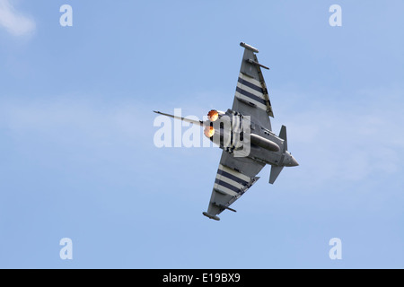 Eurofighter Typhoon pulling a tight turn with engines in reheat - Stock Photo