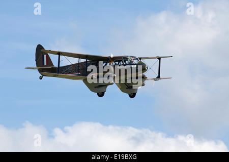 De- havilland Dragon rapide flying - Stock Photo