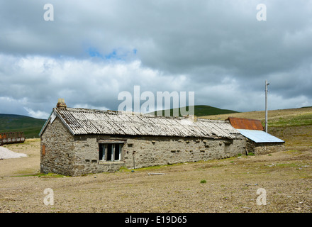 Derelict building, Silverband Mine, Great Dun Fell, Milburn Forest, Cumbria, England, United Kingdom, Europe. - Stock Photo