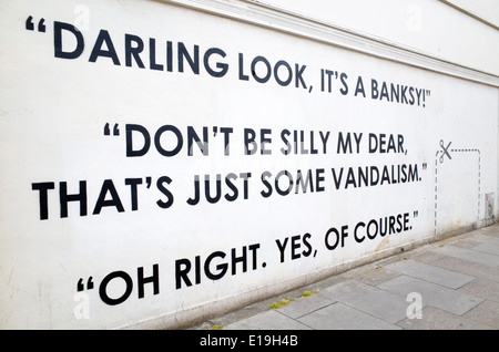 New graffiti on the wall where the Banksy 'Slave Labour' mural was removed and sold, Wood Green, Haringey, London, - Stock Photo