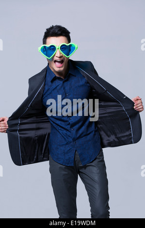 Hip young man wearing big sunglasses - Stock Photo