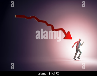Man running away from a dropping chart - Stock Photo