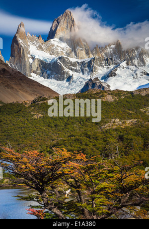 Fitz Roy towering high above Laguna Capri in Patagonia, Argentina - Stock Photo