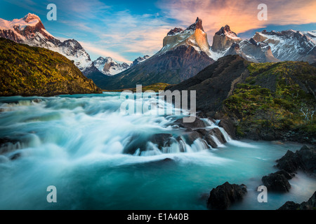 Los Cuernos towering above Salto Grande and Lago Nordenskjold, Torres del Paine, Chilean Patagonia. - Stock Photo