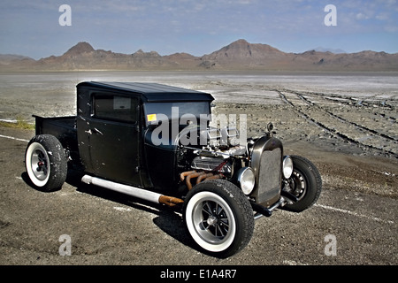 Flooded Bonneville Salt Flats in Utah with the drag - Stock Photo