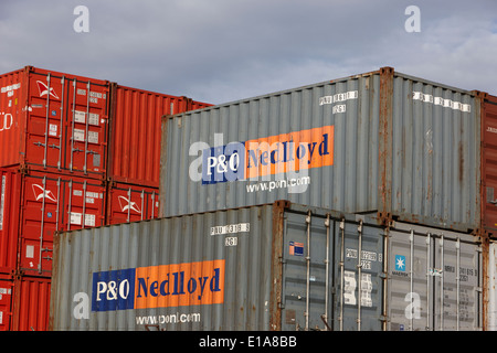 shipping containers piled up at Ushuaia docks Argentina - Stock Photo