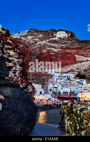 Night shot of Ammoudi Bay with Oia Santorini Greece above. - Stock Photo