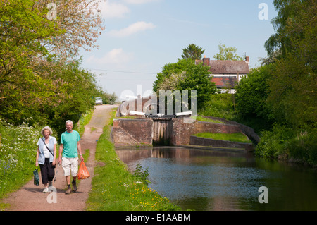 Towpath and locks on the Staffordshire and Worcestershire Canal - Stock Photo