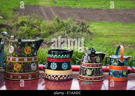 painted jugs decorate a narrowboat moored on the Staffordshire and Worcestershire Canal in the Black Country, England - Stock Photo