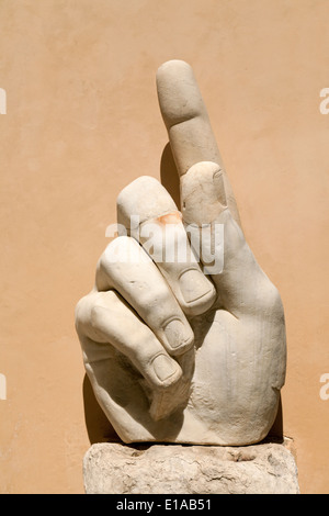Massive hand sculpture of the Emperor Constantine with finger pointing upwards, Musei Capitolini, Rome Italy - Stock Photo