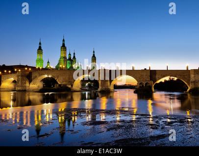 Basilica ' El Pilar' over Ebro river. Dusk view.Zaragoza, Spain. - Stock Photo