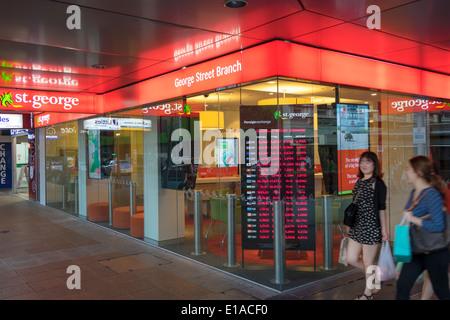 Brisbane Australia Queensland Central Business District CBD George Street St. George Bank branch banking Asian woman - Stock Photo
