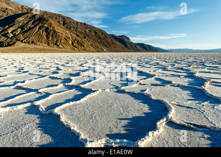 Polygonal salt pans and Black Range, Badwater Basin, Death Valley National Park, California USA - Stock Photo