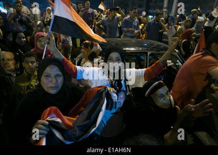 Cairo, Egypt. 28th May, 2014. Egyptians wave national flags during a rally to celebrate the presidential election - Stock Photo