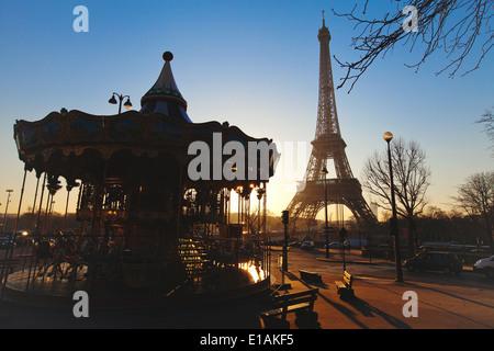carousel near Eiffel tower in Paris, France - Stock Photo