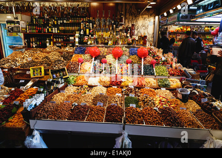 Dried Fruit and Nuts Stand in the La Boqueira Market, Barcelona, Catalonia, Spain - Stock Photo