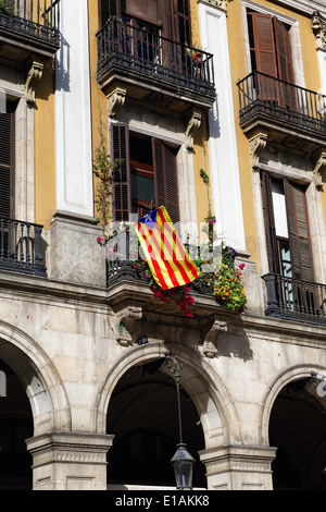 Flag of Catalonia Displayed on a Balcony, Plaza Royal, Barcelona, Catalonia, Spain - Stock Photo