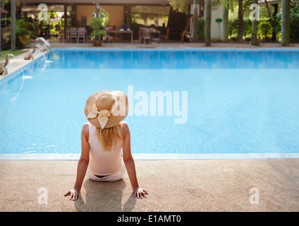 enjoy vacations in luxury hotel with swimming pool - Stock Photo