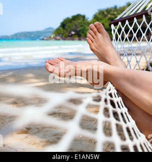 relax in hammock on the beach - Stock Photo