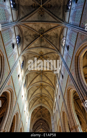 Ceiling of the nave of a famous medieval European cathedral; high gothic architecture; high vaulted ceiling; clerestory - Stock Photo