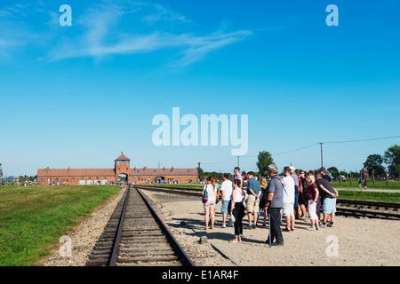Europe, Poland, Silesia, Oswiecim, tourist at Auschwitz-Birkenau, German Nazi Concentration Camp and Extermination - Stock Photo