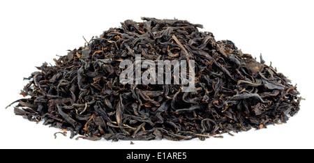 dry black tea leaves isolated on white - Stock Photo