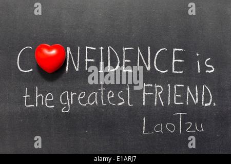 famous ancient Chinese philosopher Lao Tzu quote interpretation handwritten on blackboard - Stock Photo