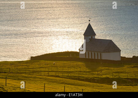 Church by the sea, Viðareiði, Viðoy, Faroe Islands, Denmark - Stock Photo