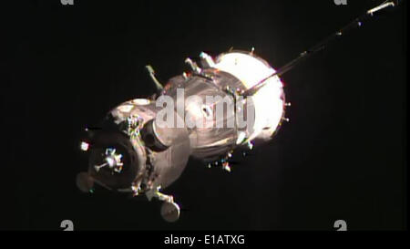 International Space Station. 29th May, 2014. A handout image provided by NASA/dpa shows the Soyuz capsule approaching - Stock Photo