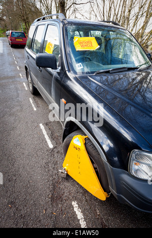 BATH, UK - MARCH 22 2014 : A car which has been clamped by the DVLA because it is untaxed. - Stock Photo