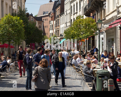 People sitting in the sun at Jourdan square in the EU district in Brussels, Belgium - Stock Photo