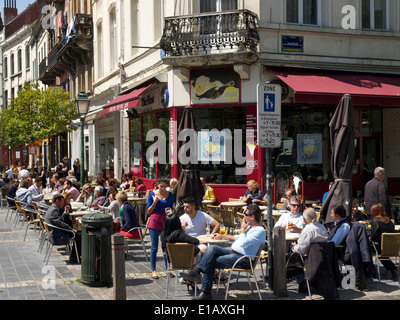 People sitting in the sun at a streetcorner cafe on Jourdan square in the EU district of Brussels, Belgium - Stock Photo