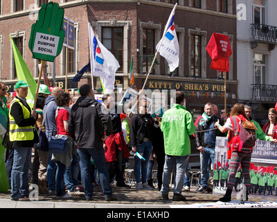 Group of people protesting in the streets at the European Commission in Brussels Belgium - Stock Photo